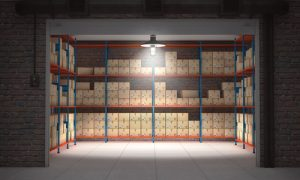 A storage unit is stacked with boxes.