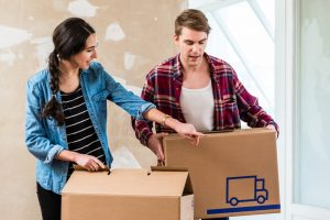 Couple storing moving boxes