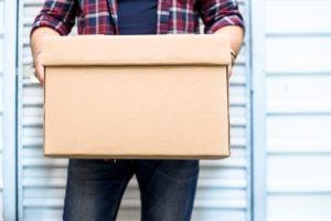 man holding storage box