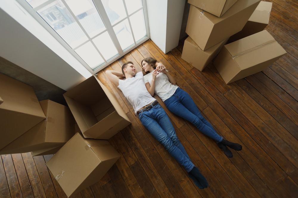 couple laying amongst boxes